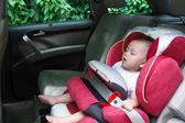 Baby girl asleep in car seat — Stock Photo
