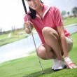 Young womholding golf clubs — Stock Photo #36537457