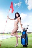 Sexy woman holding golf clubs — Stock fotografie
