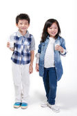 Boy and girl drinking milk — Stockfoto