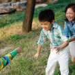 Children playing games outdoors — Stock Photo