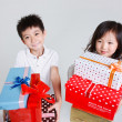 Boy and girls holding gift boxes — Stock Photo