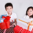 Boy and girl holding gift gifts — Stock Photo