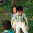 Children playing outdoors — Stock Photo