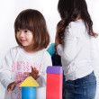 Two girls playing toy bricks — Stock Photo