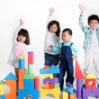 Children with toy bricks — ストック写真