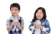 Boy and girl drinking milk — Stock Photo