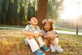 Boy and girl sitting together — Stockfoto