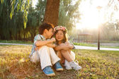 Boy and girl sitting together — Stock Photo