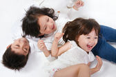 Children lying together — Stockfoto