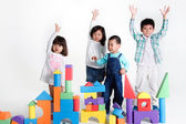 Children with toy bricks — Stock Photo