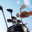 Removing golf club from bag — Stock Photo #37177007