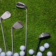 Golf balls and clubs on grass — Stock Photo #37178471