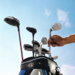 Removing golf club from bag — Stock Photo #37180819