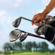 Removing golf club from bag — Stock Photo #37181495