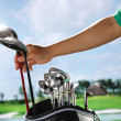 Removing golf club from bag — Stock Photo #37181723