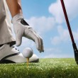 Placing golf ball on tee — Stock Photo #37181811