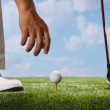Placing golf ball on tee — Stock Photo #37184585