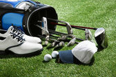 Golf shoes,hat,balls and clubs in bag — Stock Photo