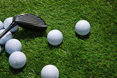 Golf balls and club — Stock Photo