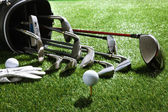Golf balls,tee,glove and clubs in bag — Stock Photo