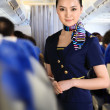 Stock Photo: Flight attendant on airplane