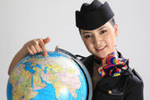 Chinese flight attendant holding a globe — Stock Photo
