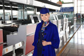 Chinese flight attendant in airport — Stock Photo