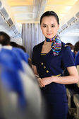 Flight attendant on airplane — Stock Photo