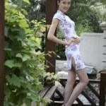 Young woman wearing cheongsam — Stock Photo #37482307