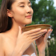 Yong woman holding a bowl — Stock Photo