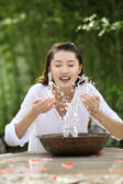 Young woman splashing water on her face — Stock Photo