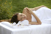 Young woman lying on massage table — Stock Photo