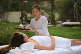 Spa worker bring tea to client — Stock Photo