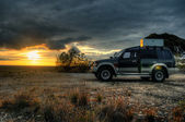 A 4wd at sunset — Stock Photo