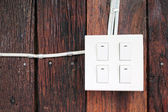 Buzzer switch on wooden wall — Stok fotoğraf