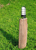 Garden lamp on the background of green grass — Stock Photo