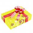 Yellow gift box with red ribbon isolated on white background — Stockfoto #26392433