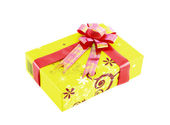 Yellow gift box with red ribbon isolated on white background — Stock Photo