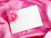Blank gift card on pink satin — Stock Photo