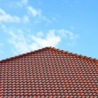 Brick roof with clear cloud blue sky — Stock Photo