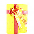 Yellow gift box with red ribbon isolated on white background — Stock Photo #26431515