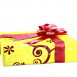 Yellow gift box with red ribbon isolated on white background — Fotografia Stock  #26431717