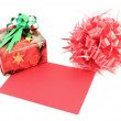 Red gift box and gift card and ribbon bow on white background — Stock Photo