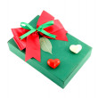 Green gift box with red ribbon on white background — Stock Photo #26436925