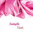 Pink satin fabric against white background — Stock Photo