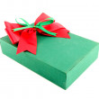 Green gift box with red ribbon on white background — Stock Photo #26437681