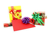 Gift box and roll paper with gift card on white background — Stock Photo