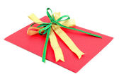 Red gift card with green and yellow bow on white background — Stock Photo