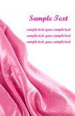 Pink satin fabric with beautiful patterns of folds — Stock Photo
